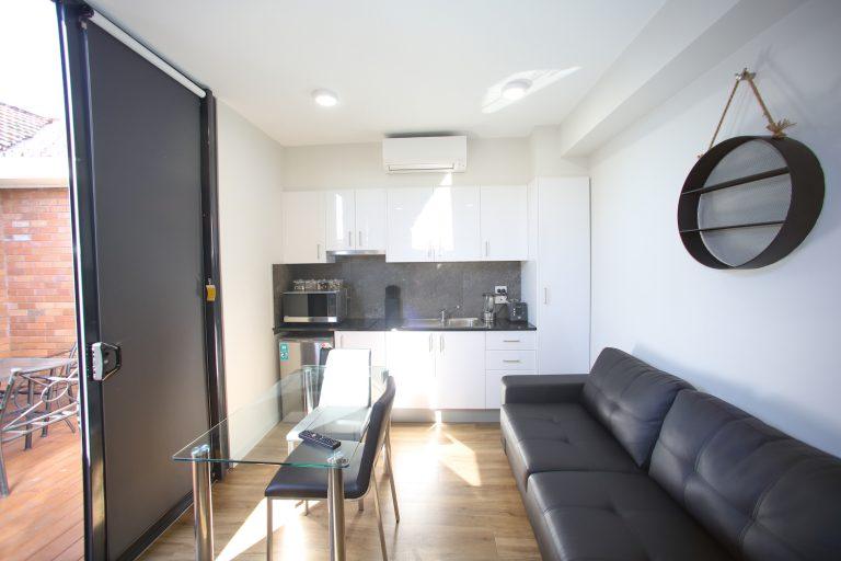 jesmond executive villas large studio apartment living area